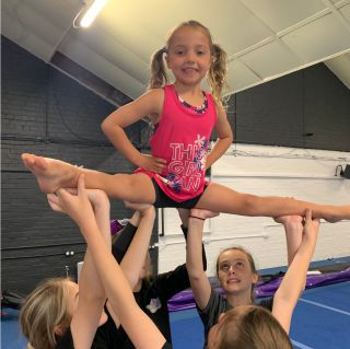 Child enjoying learning a stunt at Cheer for Fun