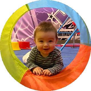 A baby enjoying a Gym Babies session