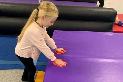 Toddler attempting a forward roll